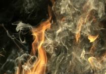 Центр города опять заволокло знакомым черным дымом