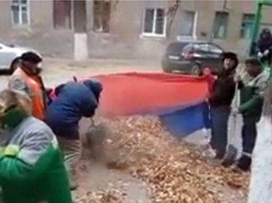 Уголовное дело завели на дворников, убиравших листву в российский флаг