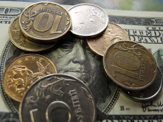 Курс доллара упал ниже 60 руб.