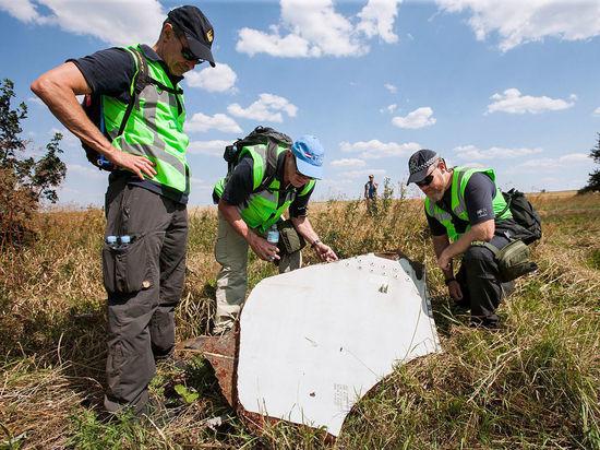 ДНР передала следствию останки и обломки с места крушения MH17
