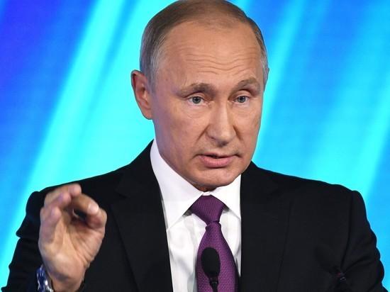 Путин позволил себя ущипнуть студенту изНигерии