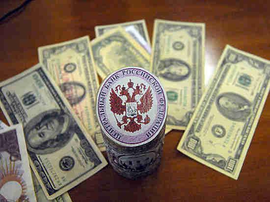 Ключевая ставка опустит доллар до 56 рублей