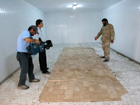 Каддафи похоронили тайно