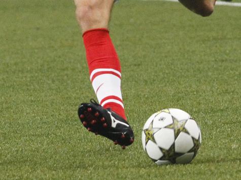 Стела с футбольным мячом возле...  Затраты на чемпионат по футболу увеличились на сотни миллиардов.