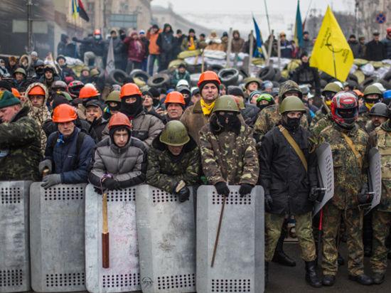 В Киеве оппозиция пошла на Раду, милиция открыла огонь