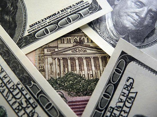 «Деревянный» упадет до 60 рублей за доллар