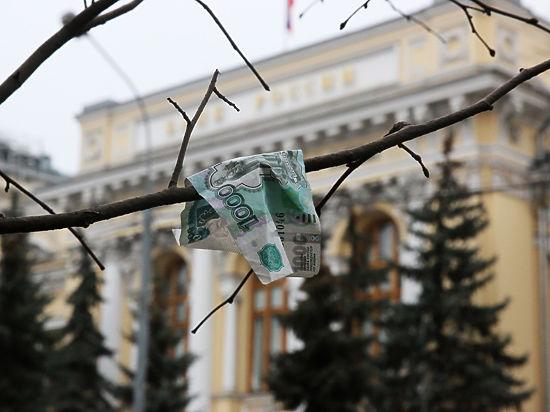 Рубль резко упал вслед за нефтью: доллар - 65, евро -77